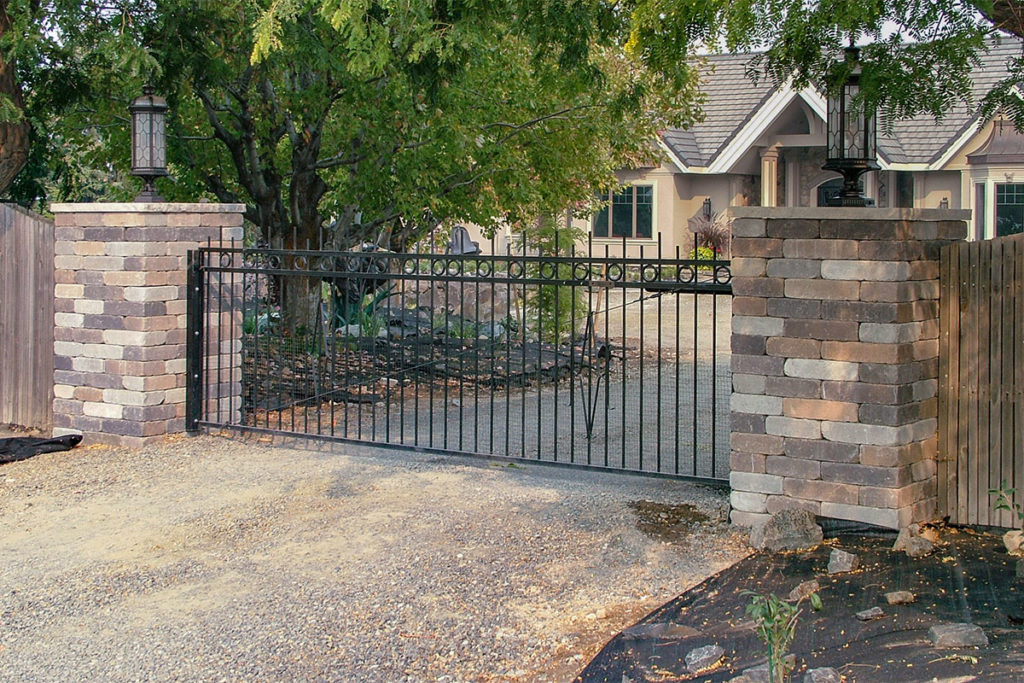 Chateau Wall™ columns with custom metal gate lights driveway