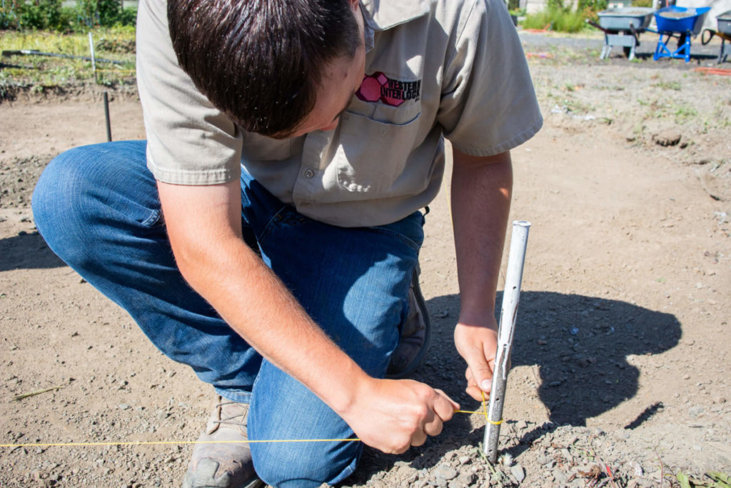 Placing stakes for hardscape grade